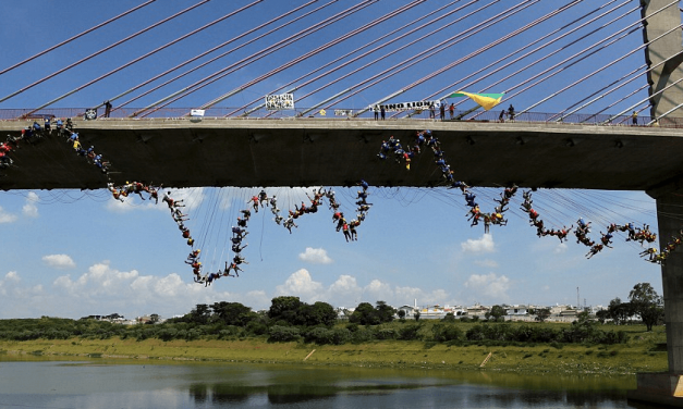 Watch 245 People Jump Off a Bridge Together in Brazil in Guinness World Record Attempt