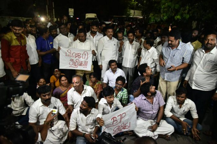 AIADMK functionaries raised slogans on condemning the searches