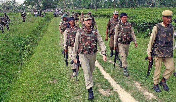 Sanjukta Parashar with loaded AK-47 of CRPF jawans