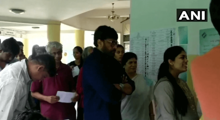 Actor Chiranjeevi stands in a queue to cast vote at polling booth no. 148 in Jubilee Hills, Hyderabad.